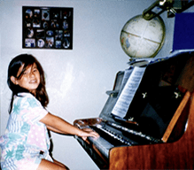 Stacey playing the piano